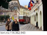 Купить «A tram passes the Hotel Roma in the lower part of Mala Strana. In ancient times it was called Malá Strana Pražské Malé MÄ›sto ( The small city of Prague...», фото № 14362943, снято 17 декабря 2013 г. (c) age Fotostock / Фотобанк Лори