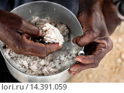 Купить «An Haitian woman eats rice in the slum of Cité Soleil, Port-au-Prince, Haiti, 17 July 2008. Rice is a basic source of nutrition for all Haitians. Cité...», фото № 14391059, снято 17 июля 2008 г. (c) age Fotostock / Фотобанк Лори