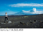 Купить «Woman watching Tolbachik volcano, Kamchatka, Russia, Eurasia», фото № 14503459, снято 4 августа 2020 г. (c) age Fotostock / Фотобанк Лори
