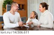Купить «Happy family with documents», фото № 14506611, снято 14 декабря 2019 г. (c) Яков Филимонов / Фотобанк Лори