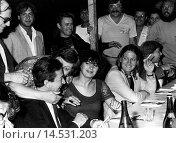 Enrico Berlinguer at the Festa dell'Unità. The Italian Communist Party General Secretary Enrico Berlinguer joking around with some militants during the Festa dell'Unità. Venice, 19th July 1981. Редакционное фото, фотограф ARNOLDO MONDADORI EDITORE S.P. / age Fotostock / Фотобанк Лори