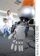 Humanoid robot for automotive assembly tasks in collaboration with people and and LWR robot, using haptic teleoperation with force feedback. Safety in... Стоковое фото, фотограф Javier Larrea / age Fotostock / Фотобанк Лори
