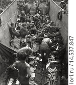 Купить «Casualties of the Allied Forces being loaded onto an LCVP. On the coast of New Georgia (Salomon Islands) the injured in urgent need of a hospital ship...», фото № 14537847, снято 15 июля 2020 г. (c) age Fotostock / Фотобанк Лори