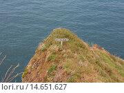 Купить «Sign on a cliff, Funchal, Portugal.», фото № 14651627, снято 24 января 2019 г. (c) age Fotostock / Фотобанк Лори