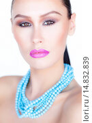 Купить «Woman Wearing Purple Lipstick and Turquoise Beads Necklace», фото № 14832839, снято 23 июня 2012 г. (c) age Fotostock / Фотобанк Лори