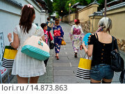 Купить «Japanese teens dressed in very modern clothing contrast with others wearing traditional kimonos near Kiyomizu Temple.», фото № 14873863, снято 17 июля 2013 г. (c) age Fotostock / Фотобанк Лори