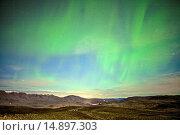 Купить «AURORA BOREALIS - ICELAND», фото № 14897303, снято 10 декабря 2013 г. (c) age Fotostock / Фотобанк Лори