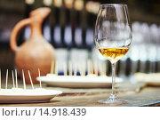 Купить «white glass of wine for tasting», фото № 14918439, снято 22 сентября 2015 г. (c) Дмитрий Калиновский / Фотобанк Лори