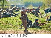 Купить «Re-enactment of the WWII battle. German Nazi soldiers attack», фото № 14918507, снято 10 мая 2015 г. (c) Дмитрий Калиновский / Фотобанк Лори