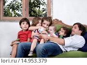 Купить «Children sitting with father», фото № 14953379, снято 30 декабря 2007 г. (c) age Fotostock / Фотобанк Лори
