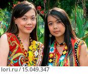 Купить «HAPPY LADIES SMILES FROM THE LAND OF HORNBILLS IN CITYDAY EVENT. TAKEN IN EAST MALAYSIA.», фото № 15049347, снято 4 августа 2007 г. (c) age Fotostock / Фотобанк Лори