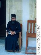 Купить «Cypriot clergyman, middle-aged, sitting in long black robe on wooden chair, Cyprus», фото № 15065167, снято 5 июля 2020 г. (c) age Fotostock / Фотобанк Лори