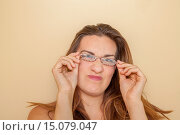 Купить «Young woman wearing glasses.», фото № 15079047, снято 11 августа 2014 г. (c) age Fotostock / Фотобанк Лори