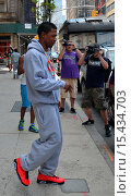 Купить «Nick Cannon, who recently confirmed reports that he and wife Mariah Carey have separated and have been living apart for months, is spotted leaving his...», фото № 15434703, снято 26 августа 2014 г. (c) age Fotostock / Фотобанк Лори