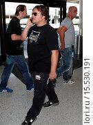 Купить «Jack Black pretends to be on phone like paris hilton as he departs LAX Featuring: Jack Black Where: Los Angeles, California, United States When: 04 Oct 2014 Credit: WENN.com», фото № 15530191, снято 4 октября 2014 г. (c) age Fotostock / Фотобанк Лори