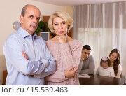 Купить «Couple with kid and bills at table and sad parents apart», фото № 15539463, снято 12 ноября 2019 г. (c) Яков Филимонов / Фотобанк Лори
