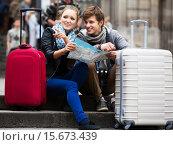 Купить «Young couple with a map», фото № 15673439, снято 18 марта 2018 г. (c) Яков Филимонов / Фотобанк Лори