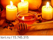 Купить «Beautiful candles, bowl of honey and fresh orange fruits on wooden table. Evening natural light.», фото № 15745315, снято 1 декабря 2019 г. (c) age Fotostock / Фотобанк Лори