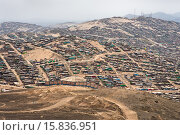 Купить «A sprawling settlement of houses and wooden shacks is seen on the dusty hillsides of Pachacútec, a desert suburb of Lima, Peru, 24 January 2015. Although...», фото № 15836951, снято 24 января 2015 г. (c) age Fotostock / Фотобанк Лори
