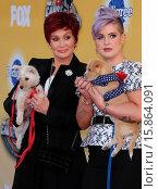 Купить «FOX's Cause For Paws: An All-Star Dog Spectacular held at Barker Hangar at the Santa Monica Airport - Arrivals Featuring: Sharon Osbourne, Kelly Osbourne...», фото № 15864091, снято 22 ноября 2014 г. (c) age Fotostock / Фотобанк Лори