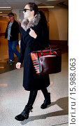 Купить «Emmy Rosssum wrapped up warm in a long coat and biker boots, returns home for the holidays by way of at Los Angeles International Airport (LAX) Featuring...», фото № 15988063, снято 28 декабря 2014 г. (c) age Fotostock / Фотобанк Лори