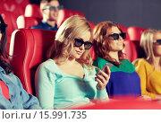 Купить «happy woman with smartphone in 3d movie theater», фото № 15991735, снято 19 января 2015 г. (c) Syda Productions / Фотобанк Лори
