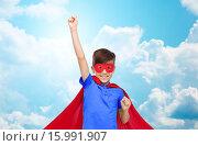 Купить «boy in red superhero cape and mask showing fists», фото № 15991907, снято 6 ноября 2015 г. (c) Syda Productions / Фотобанк Лори