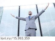 Купить «young smiling businessman over office building», фото № 15993359, снято 19 августа 2014 г. (c) Syda Productions / Фотобанк Лори