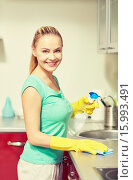 Купить «happy woman cleaning table at home kitchen», фото № 15993491, снято 25 января 2015 г. (c) Syda Productions / Фотобанк Лори
