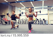 Купить «young man and woman training with barbell in gym», фото № 15995559, снято 30 ноября 2014 г. (c) Syda Productions / Фотобанк Лори