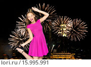 Купить «happy young woman in crown over firework at night», фото № 15995991, снято 31 октября 2015 г. (c) Syda Productions / Фотобанк Лори