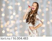 Купить «happy young woman or teen girl in fancy dress», фото № 16004483, снято 31 октября 2015 г. (c) Syda Productions / Фотобанк Лори