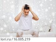 Купить «unhappy man suffering from head ache at home», фото № 16005219, снято 29 января 2015 г. (c) Syda Productions / Фотобанк Лори