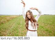 Купить «smiling young hippie woman on cereal field», фото № 16005883, снято 27 августа 2015 г. (c) Syda Productions / Фотобанк Лори