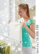 Купить «happy woman hanging clothes on dryer at home», фото № 16006199, снято 25 января 2015 г. (c) Syda Productions / Фотобанк Лори