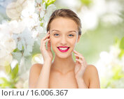Купить «smiling young woman with pink lipstick on lips», фото № 16006367, снято 31 октября 2015 г. (c) Syda Productions / Фотобанк Лори