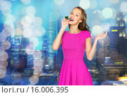 Купить «happy young woman or teen girl with party horn», фото № 16006395, снято 31 октября 2015 г. (c) Syda Productions / Фотобанк Лори