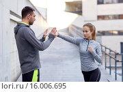 Купить «happy woman with coach working out strike outdoors», фото № 16006695, снято 17 октября 2015 г. (c) Syda Productions / Фотобанк Лори