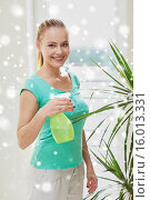 Купить «happy woman in spraying houseplants at home», фото № 16013331, снято 25 января 2015 г. (c) Syda Productions / Фотобанк Лори