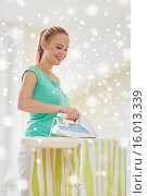 Купить «happy woman with iron and ironing board at home», фото № 16013339, снято 25 января 2015 г. (c) Syda Productions / Фотобанк Лори