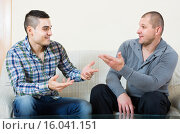 Купить «Buddies chatting in home interior», фото № 16041151, снято 23 марта 2018 г. (c) Яков Филимонов / Фотобанк Лори