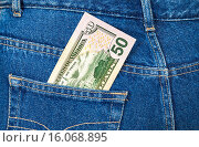 Купить «Fifty dollars bill sticking out of the blue jeans pocket», фото № 16068895, снято 17 августа 2018 г. (c) FotograFF / Фотобанк Лори