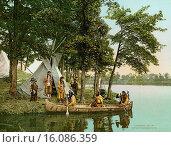MInnesota, 1904.A photochrome of the Ojibwa hunters returning to their camp in their birchbark canoe. Редакционное фото, фотограф Underwood Archives / age Fotostock / Фотобанк Лори