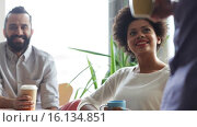 Купить «happy creative team drinking coffee in office», видеоролик № 16134851, снято 3 апреля 2015 г. (c) Syda Productions / Фотобанк Лори