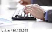 Купить «close up of businessman typing and drinking coffee», видеоролик № 16135595, снято 4 апреля 2015 г. (c) Syda Productions / Фотобанк Лори