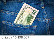 Купить «Fifty dollars bill sticking out of the blue jeans pocket», фото № 16198067, снято 17 августа 2018 г. (c) FotograFF / Фотобанк Лори