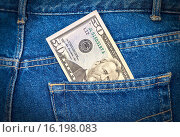 Купить «Fifty dollars bill sticking out of the blue jeans pocket», фото № 16198083, снято 17 августа 2018 г. (c) FotograFF / Фотобанк Лори