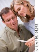 Купить «Couple with pregnancy test upset», фото № 16454675, снято 26 апреля 2019 г. (c) easy Fotostock / Фотобанк Лори