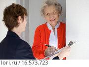 Купить «Smiling senior woman signing petetion», фото № 16573723, снято 29 февраля 2008 г. (c) easy Fotostock / Фотобанк Лори