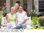 Купить «Family Sitting Outside House», фото № 16580767, снято 24 июня 2007 г. (c) easy Fotostock / Фотобанк Лори